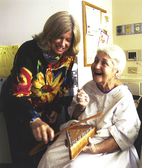 Cathy with patient on psaltery